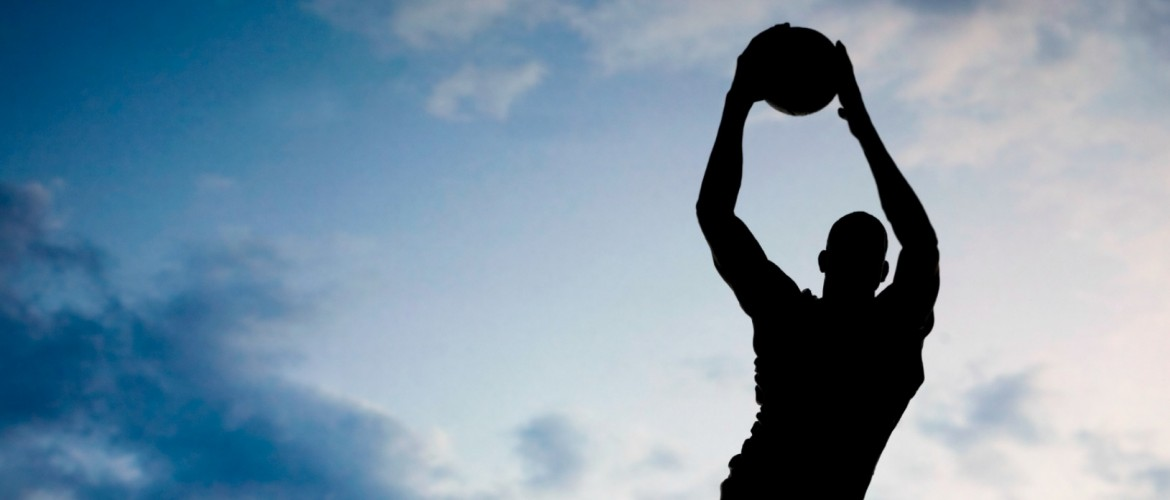 Basketball player silhouette in front of sky